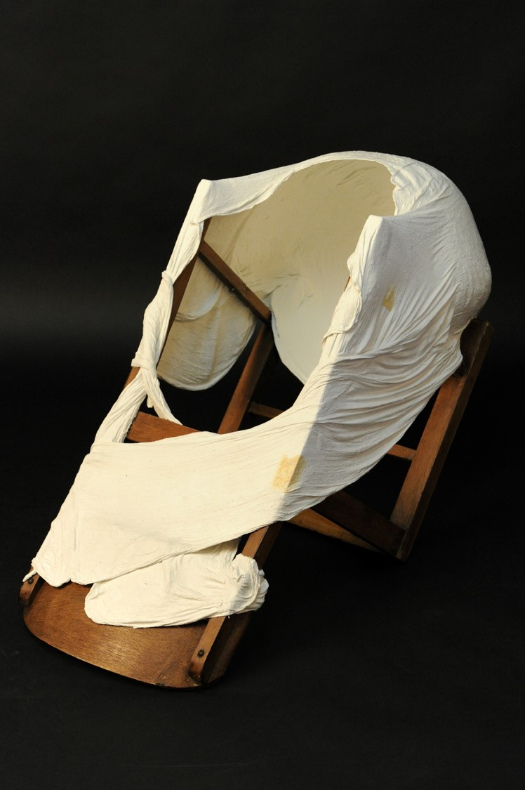 Unconsious Transference - Wooden chair, white cement, muslin, dimensions 1.2m x 40cm, 2012 Image-Nu Image.jpg