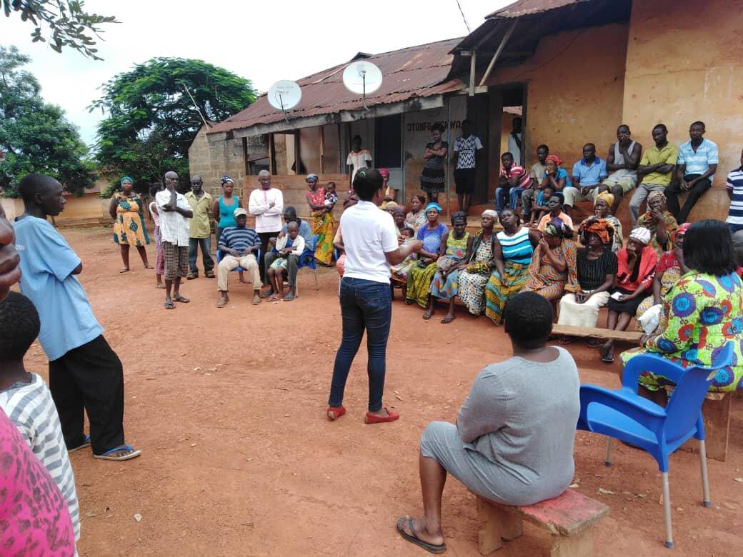 mfarmPay Team member interacting with our farmer clients in rural Ghana