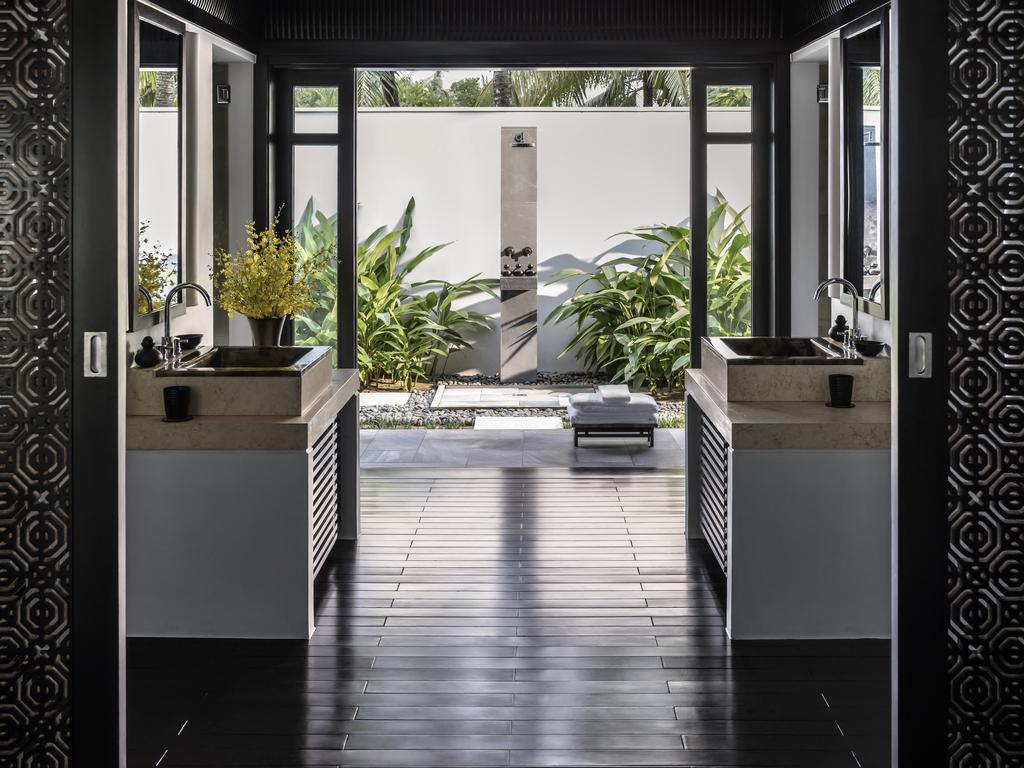 The-Nam-Hai-outdoor-shower.jpg