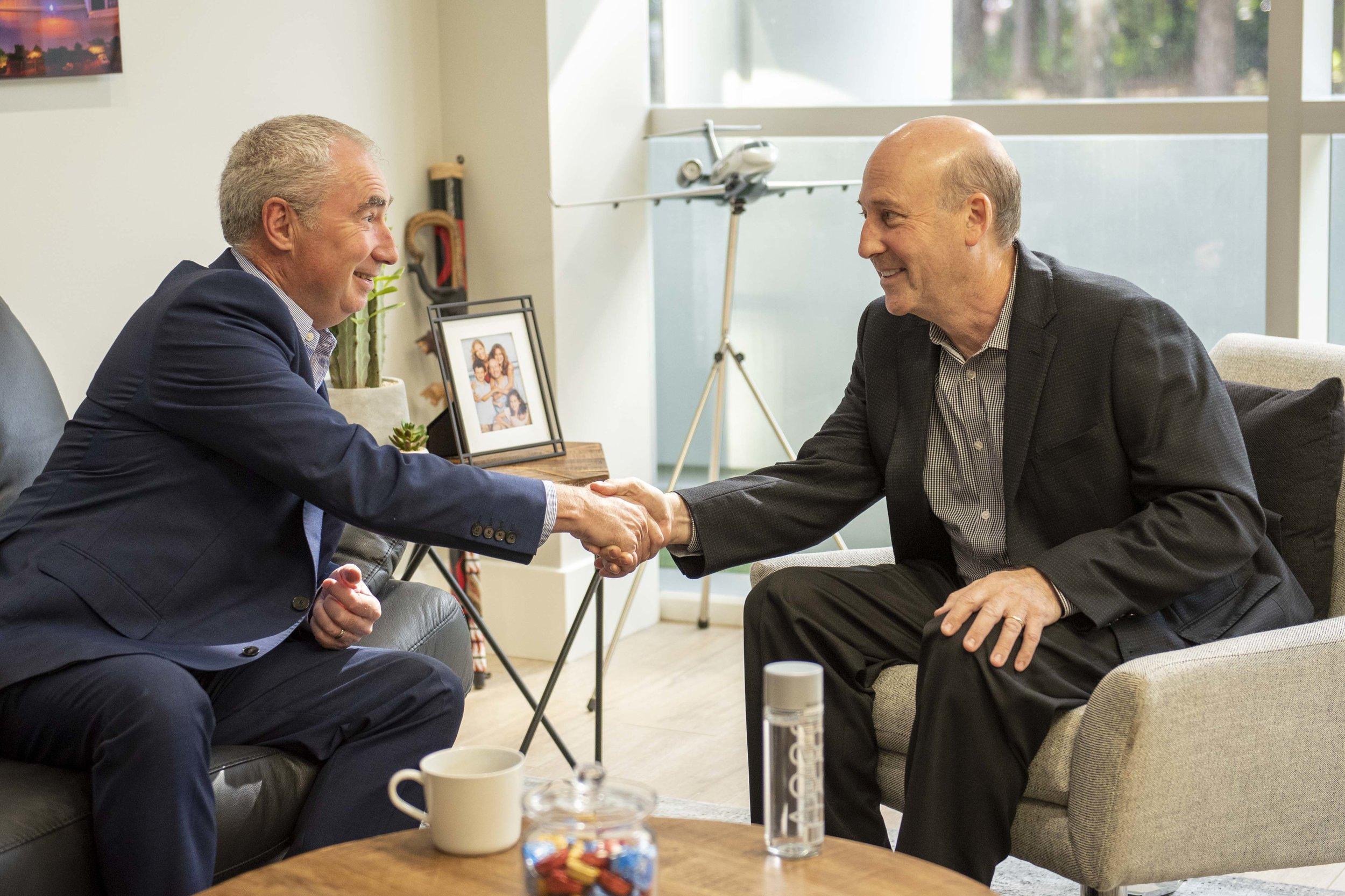 Paul & Les Handshake.jpg