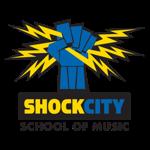 shockcityschoolofmusic-fist-logo-1x150_.png