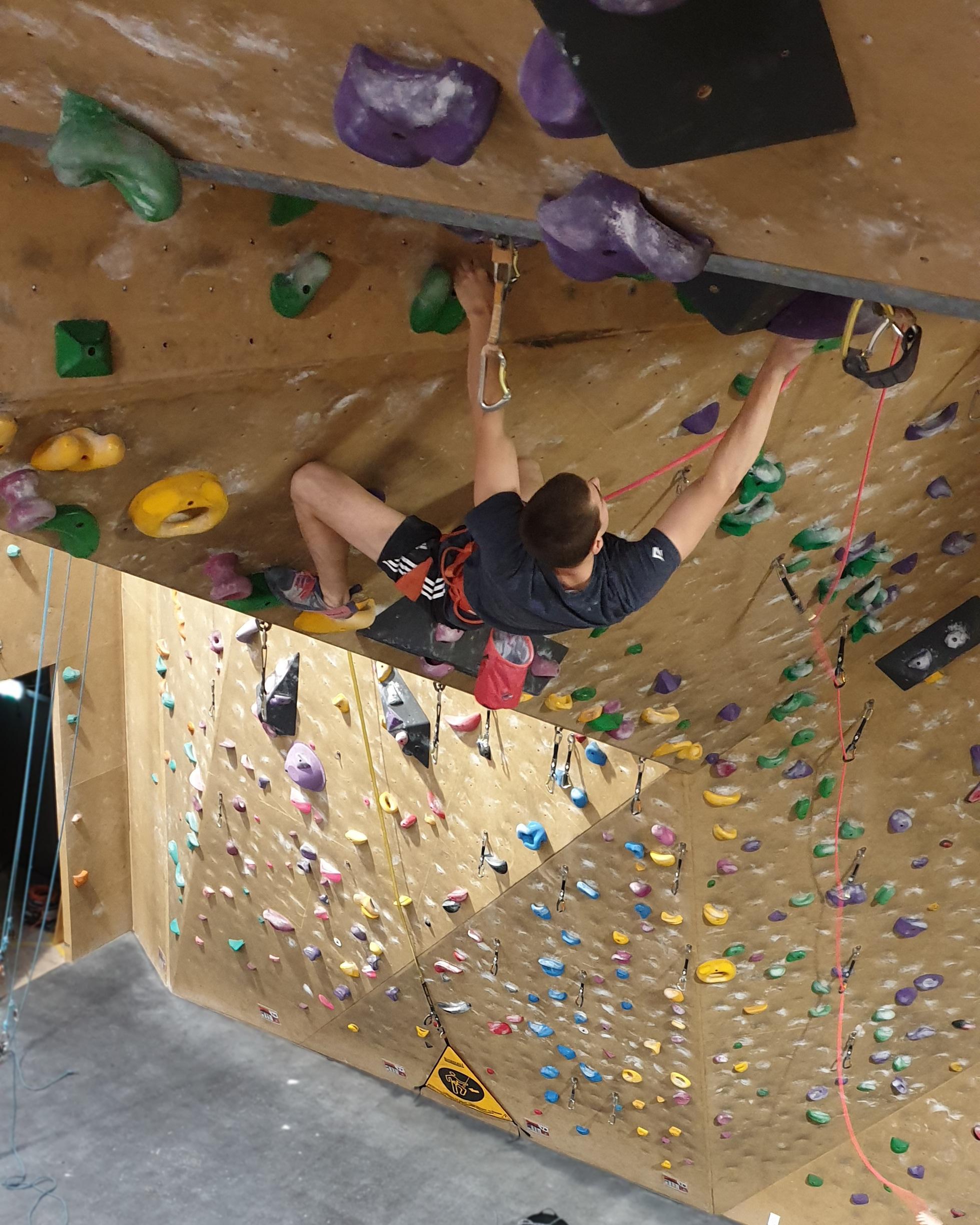 Cam Davies climbing up the lead wall