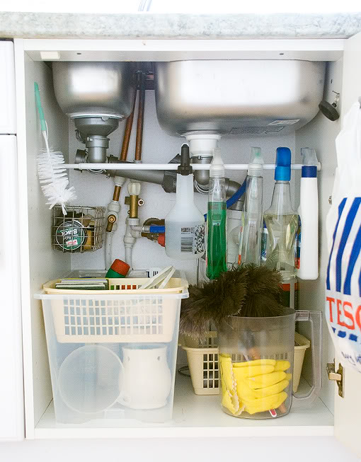 tension-rod-spray-bottles-kitchen-cabinet-organization.jpg