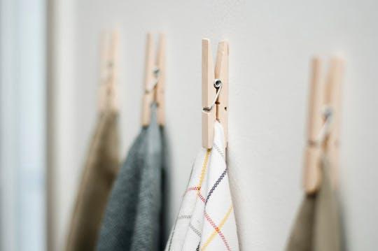 towels-clothespins-kitchen-cabinet-organization.jpg