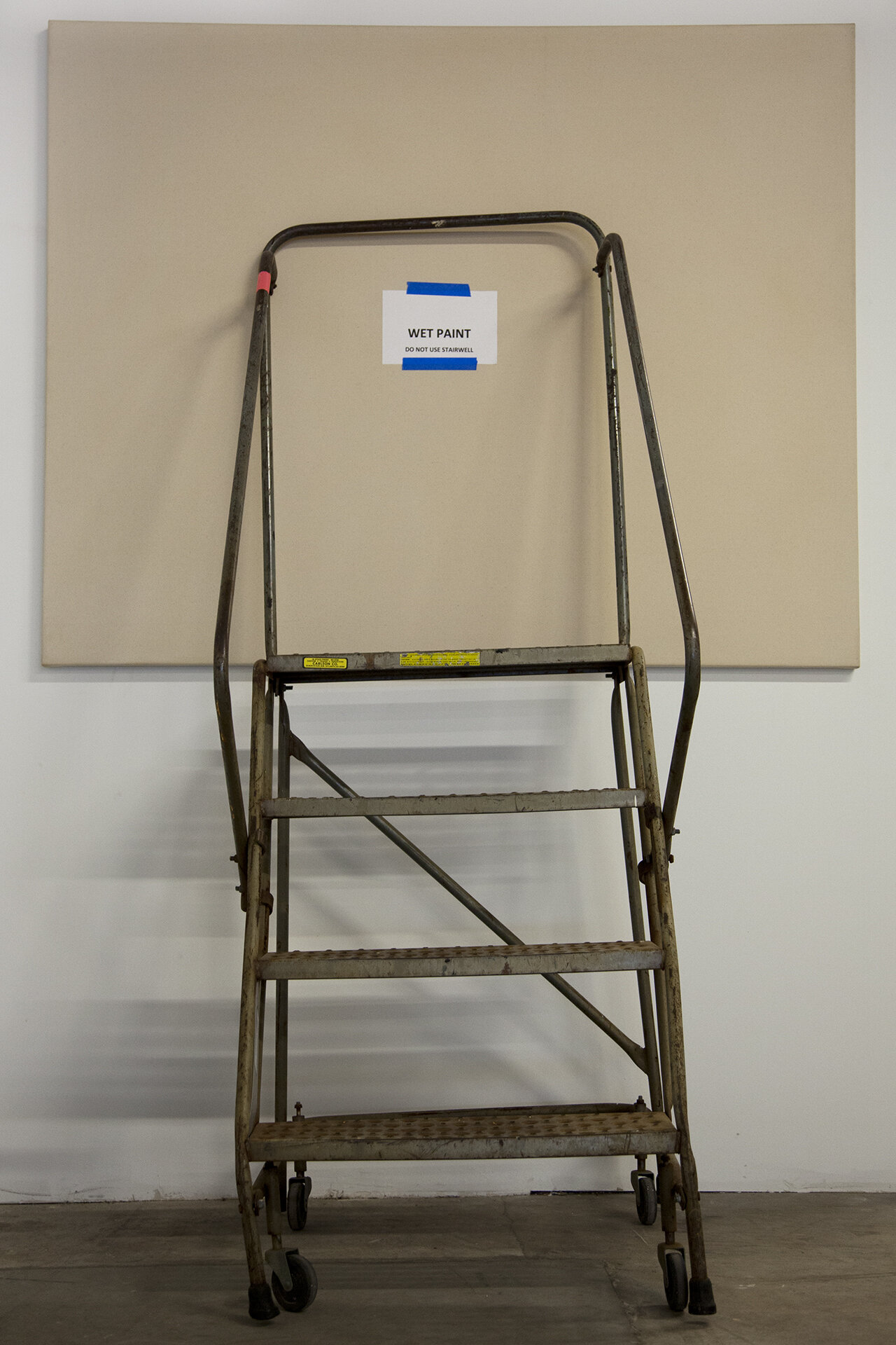 Wet Paint [Do Not Use Stairwell],  2015, paper, ink, painter's tape on canvas, step ladder, 48 x 60 inches.