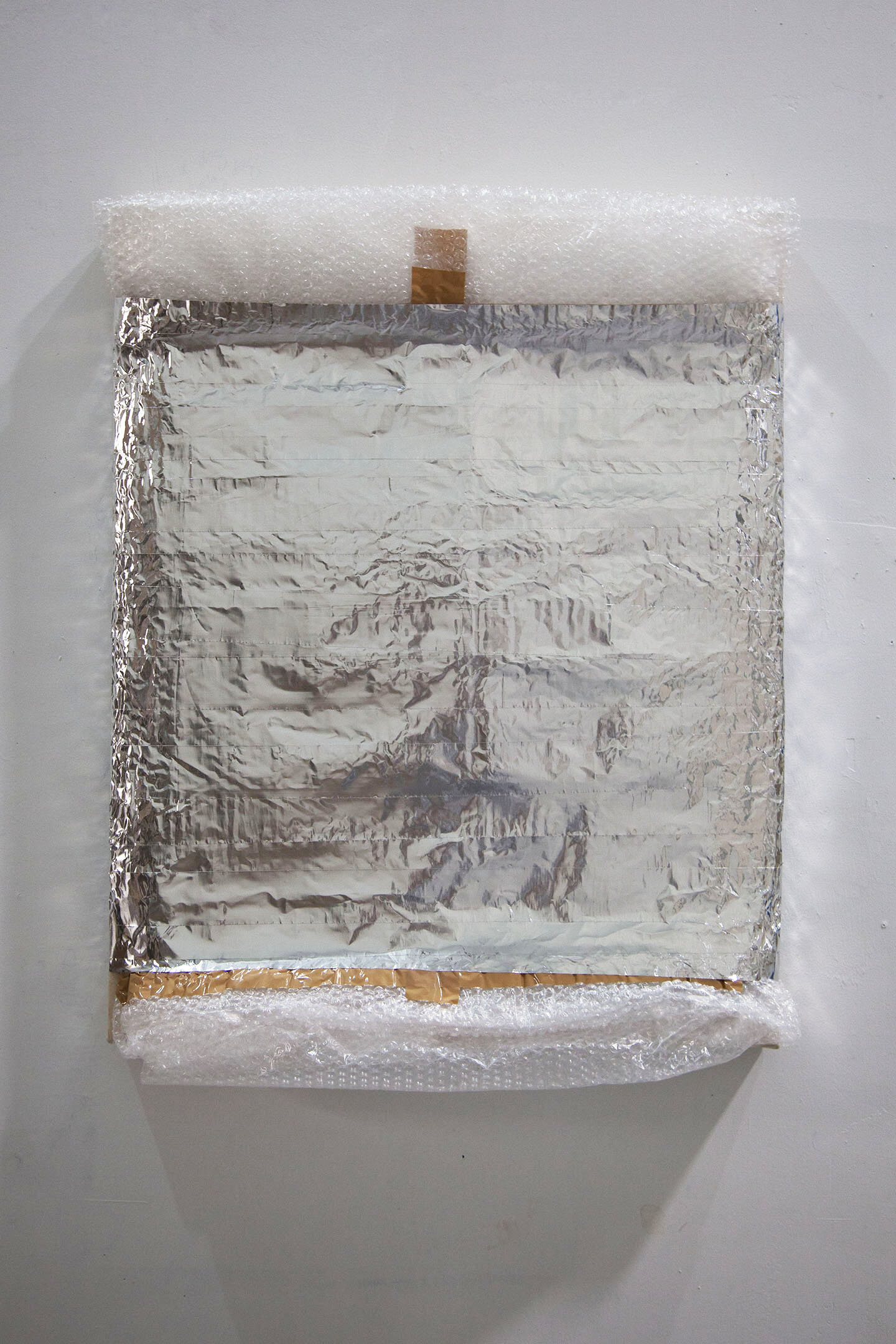 Preserved Paint [120 mL King's Blue, 120 mL Gold Yellow, 120 mL Titanium Buff Light, 120 mL Iridescent Black, 120 mL Light Violet] , 2018, acrylic on canvas over panel, plastic wrap, glassine, bubble wrap, packing tape, aluminum tape, 32 x 24 inches.