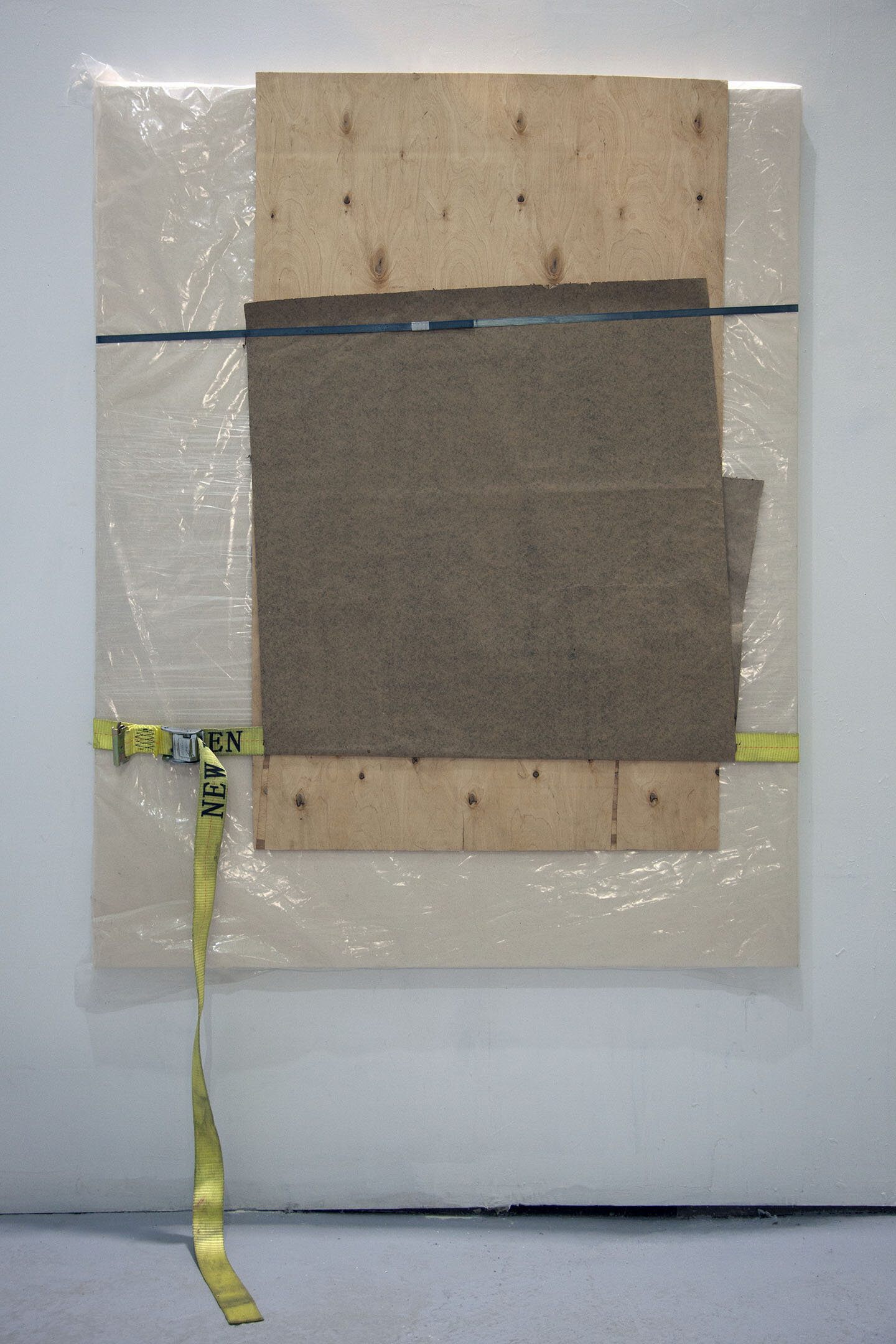 Preserved Paint [1000 mL Neutral Grey] , 2018, acrylic on canvas over panel, plastic wrap, plastic sheeting, wood, packing paper, steel banding strap, nylon strap, 61 x 48 inches.