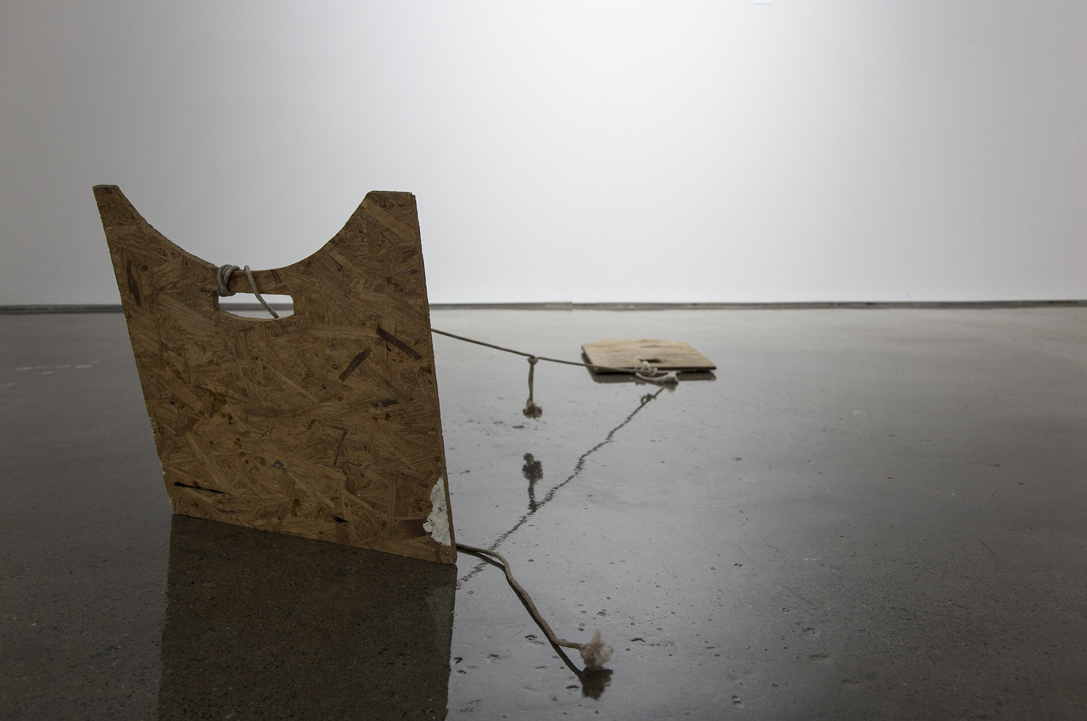 Tethered Boards , 2015, rope, wood, 108 x 24 x 24 inches.