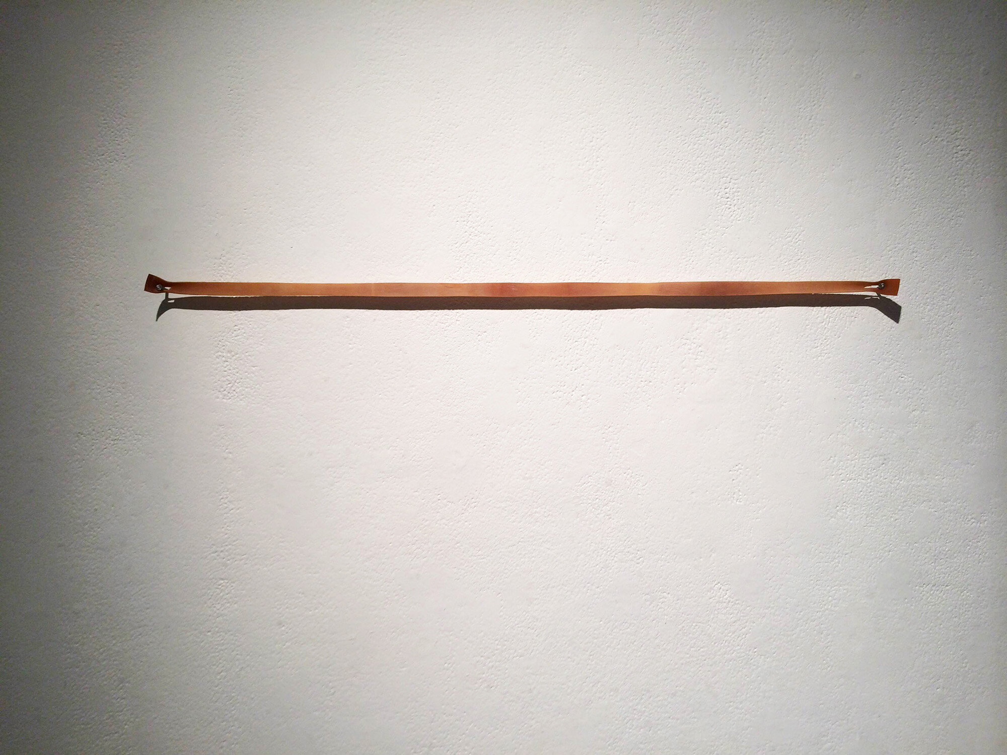 Broken Band , 2014, rubber band, 1 x 30 inches.