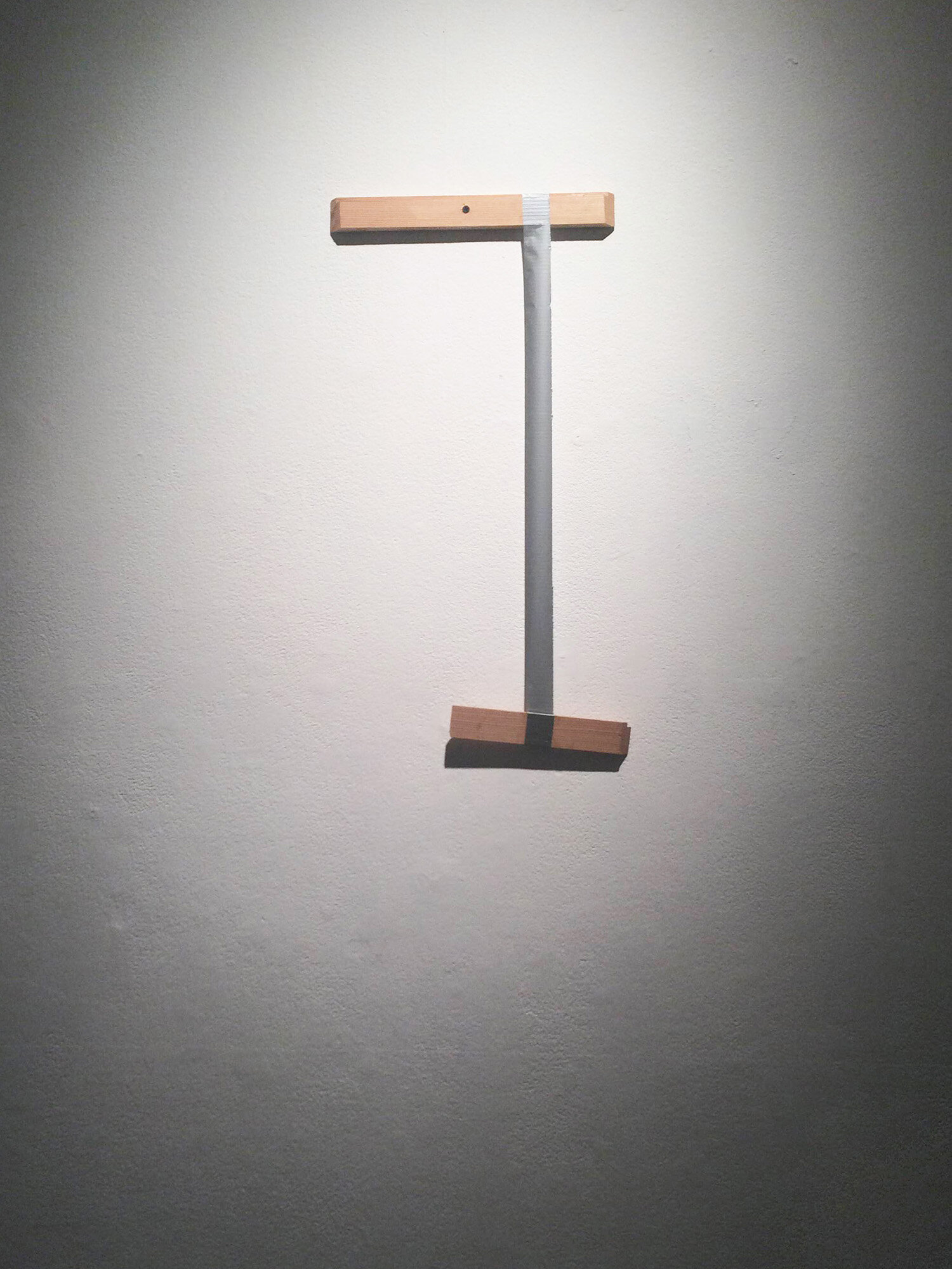 Taped Wood , 2014, duct tape, wood, 18 x 10 x 1 inches.