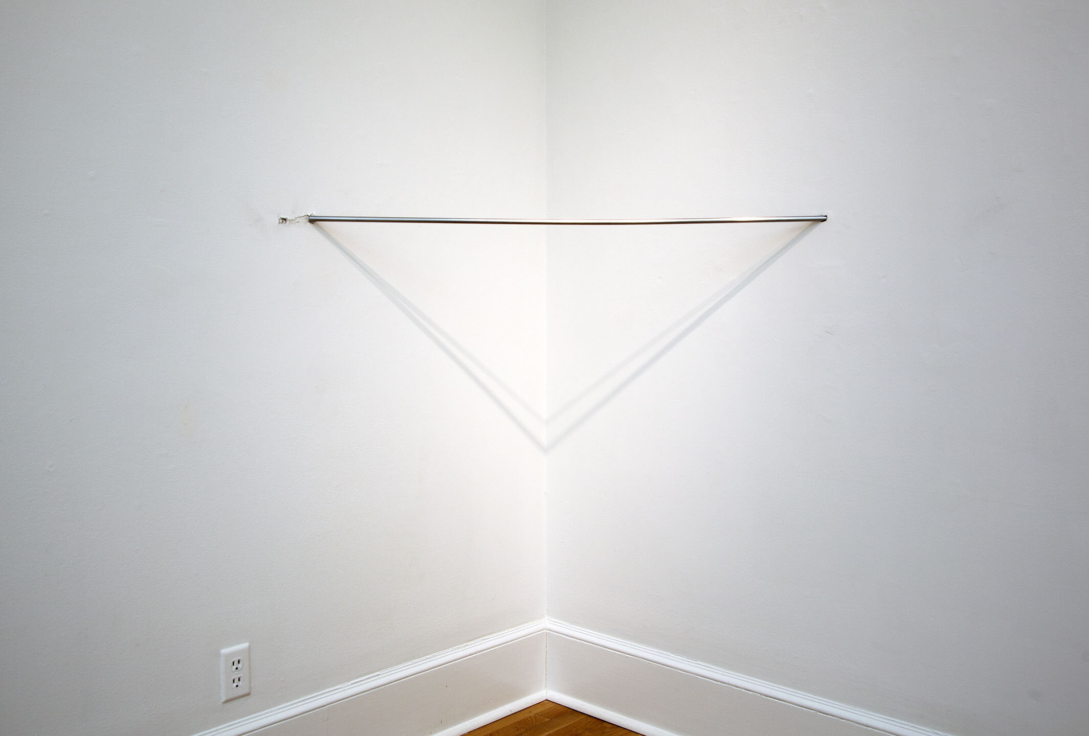 Corner Piss , 2019, steel, 48 x ½ x ½ inches.
