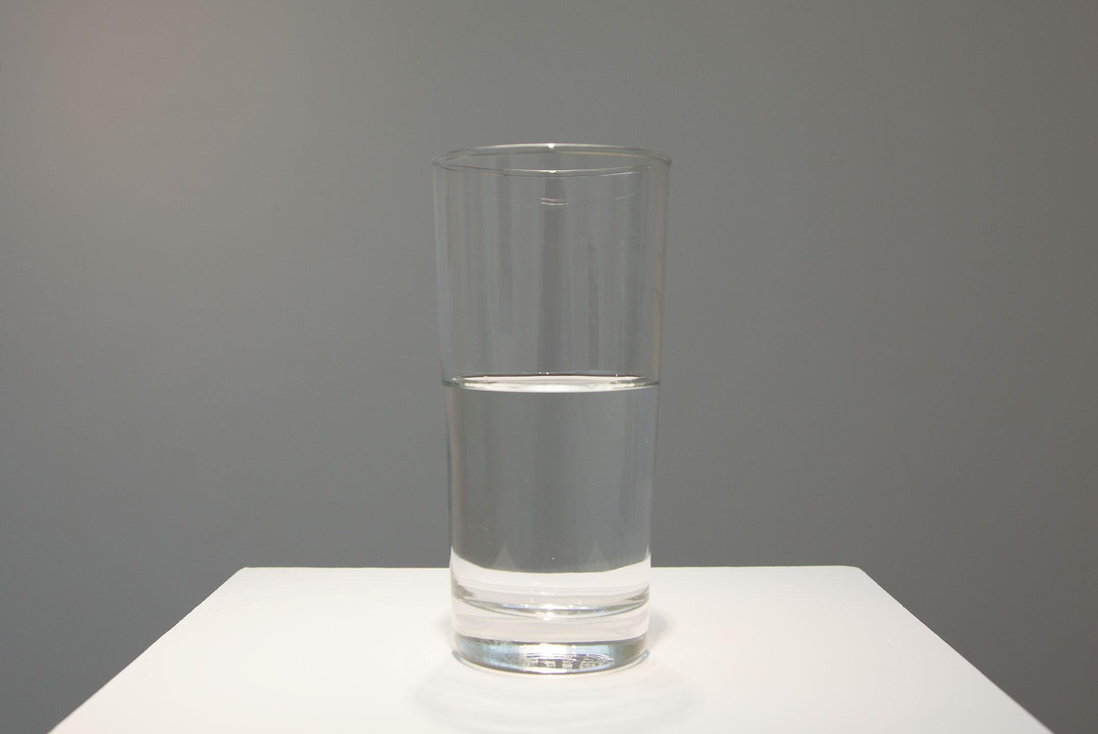 This Too Shall Pass , 2019, 7 oz. water in 14 oz. glass, 6 x 3 x 3 inches.