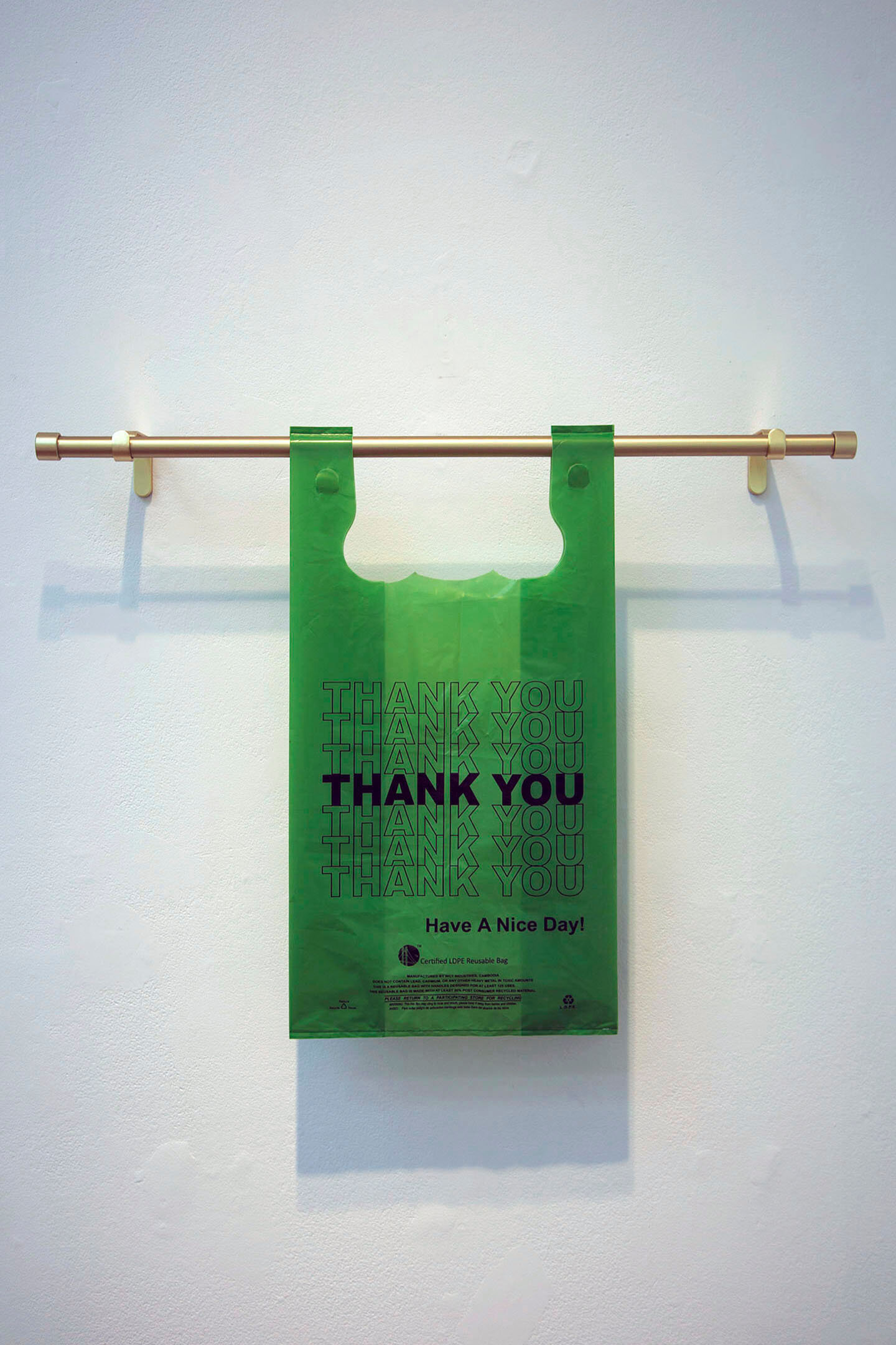 Thank You Thank You Thank You Thank You Thank You Thank You Thank You , 2019, reusable plastic bag, brushed brass curtain rod, 22 x 29½ x 4 inches.