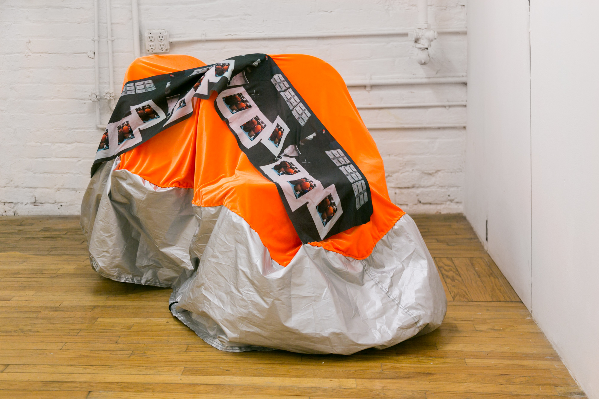 Laura Hunt,  Motorcycle Cover 2 , 2018, custom printed cotton, velvet, and altered motorcycle cover with hand-sewing, approximately 60 x 36 inches, dimensions variable. Installation view, Laura Hunt,  Motorcycle Covers , 2018, 321 Gallery, Brooklyn, NY.