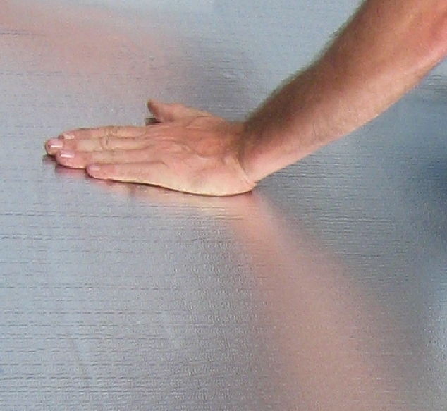 The aluminum surface of FlexClad is UV-resistant and reflects heat to reduce internal temperatures. FlexClad can be left exposed to the elements indefinitely.