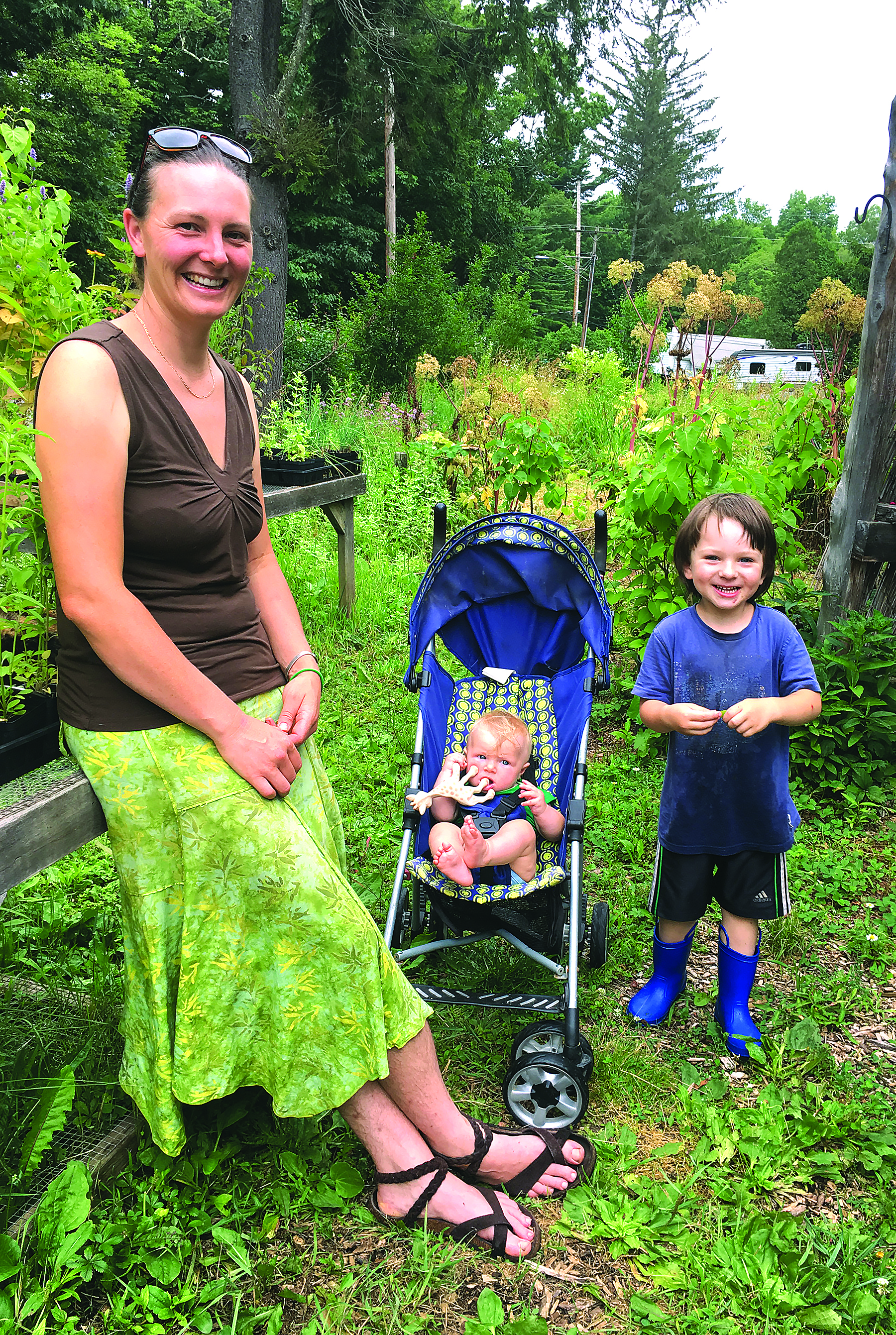 Cheyenne Zigmund and her two children take a break from chores on Root 'N Roost Farm in White Sulphur Springs.