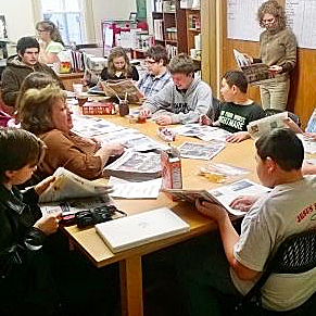 ON DEADLINE  An early  Manor Ink  staff meeting at the Livingston Manor Free Library. Graphic artist and production manager at the time, Carolyn Bivins, is seated second from left.  Manor Ink file photo