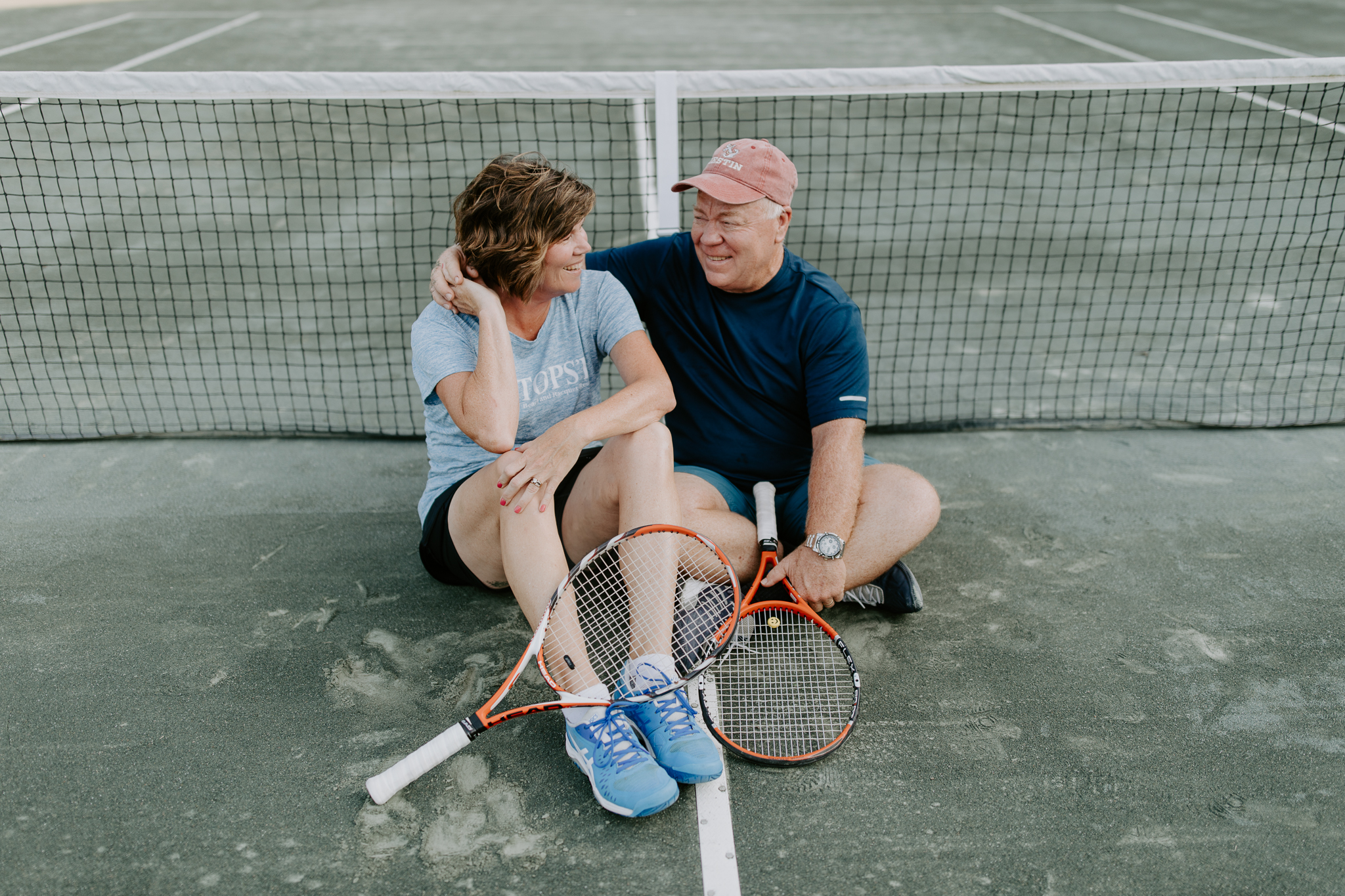 Couples Session with older couple on tennis courts