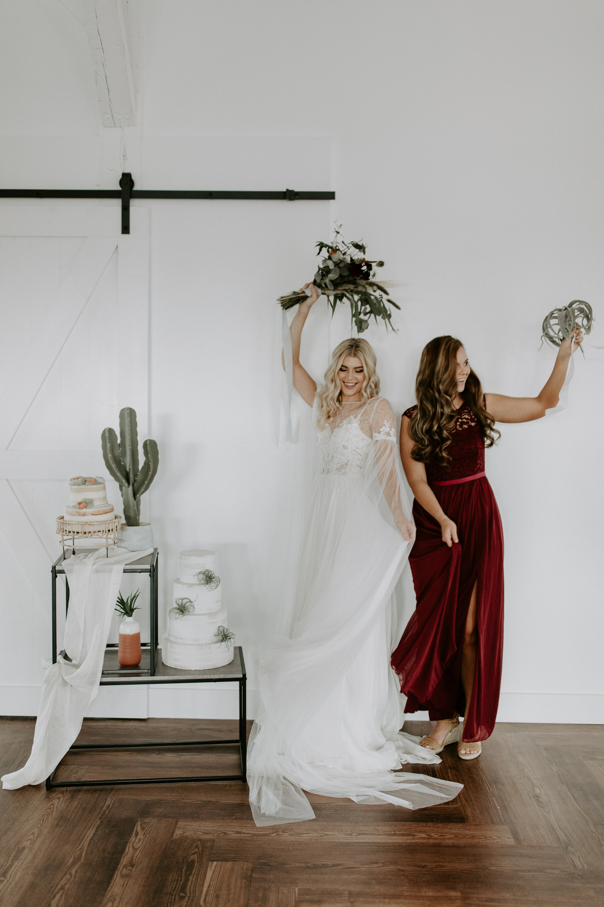 Modern, white wall bride and bridesmaid photo