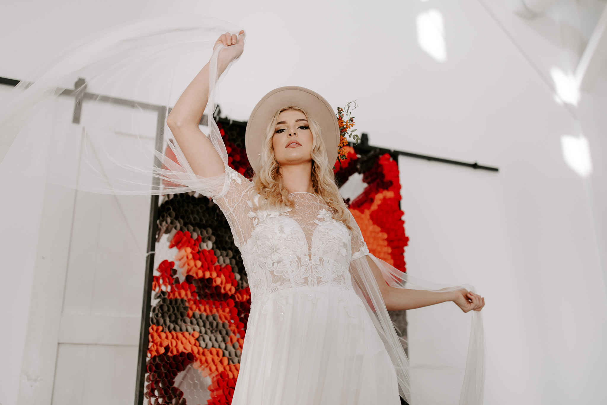 Modern bride with white walls and clean aesthetic, bridal dress with sleeves