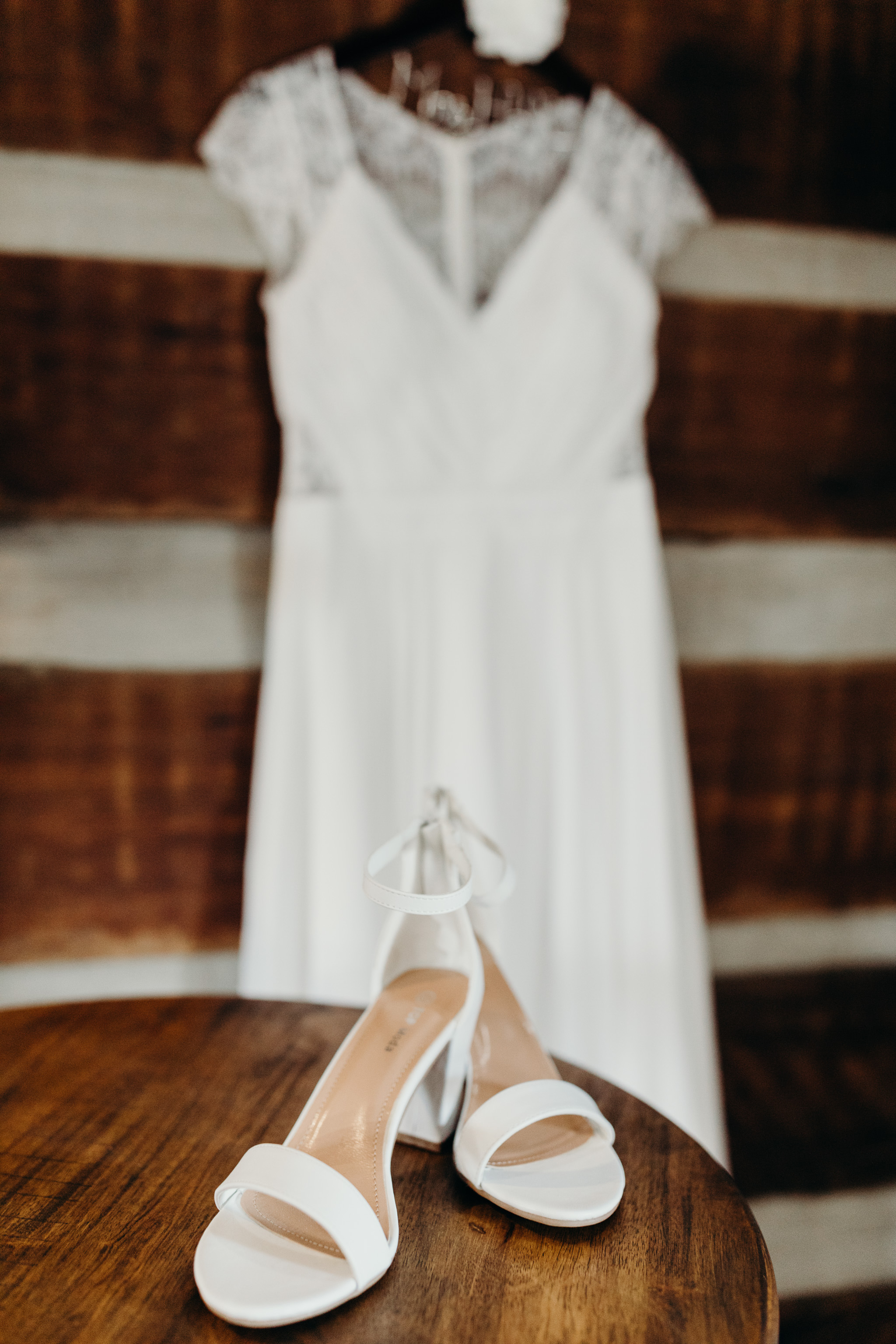 Bride's dress and shoes detail photo