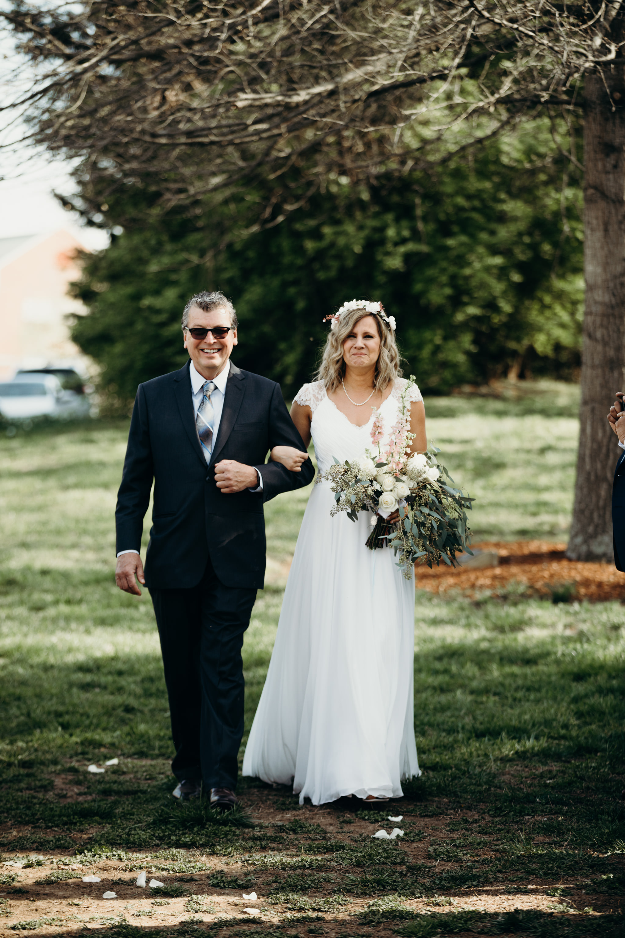 Bride walking down the aisle at summer wedding in Brentwood, Tennessee