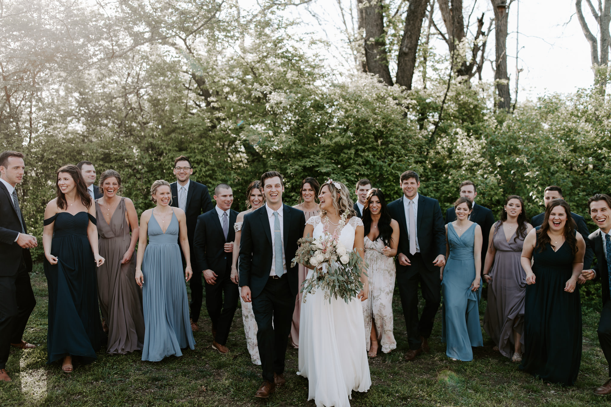 Wedding party portraits with pastel and spring colors, with mix matched bridesmaids dresses, at Cool springs house in Brentwood Tennessee