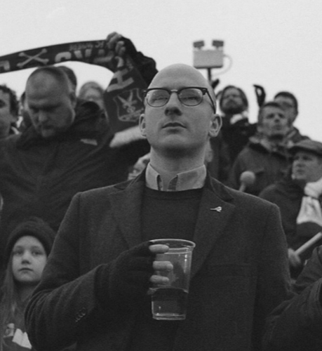 Joshua Boyd -Whitehawk FC 'Ultra' Fan - Josh got involved with Whitehawk Football Club a few years back thanks to being bored on a Saturday. Someone mentioned the Whitehawk 'Ultras' and off he went. He's been there ever since thanks to the community, humour, fun, and football.
