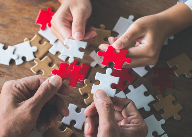 Two-hands-puzzle-pieces-iStock-image2.jpg