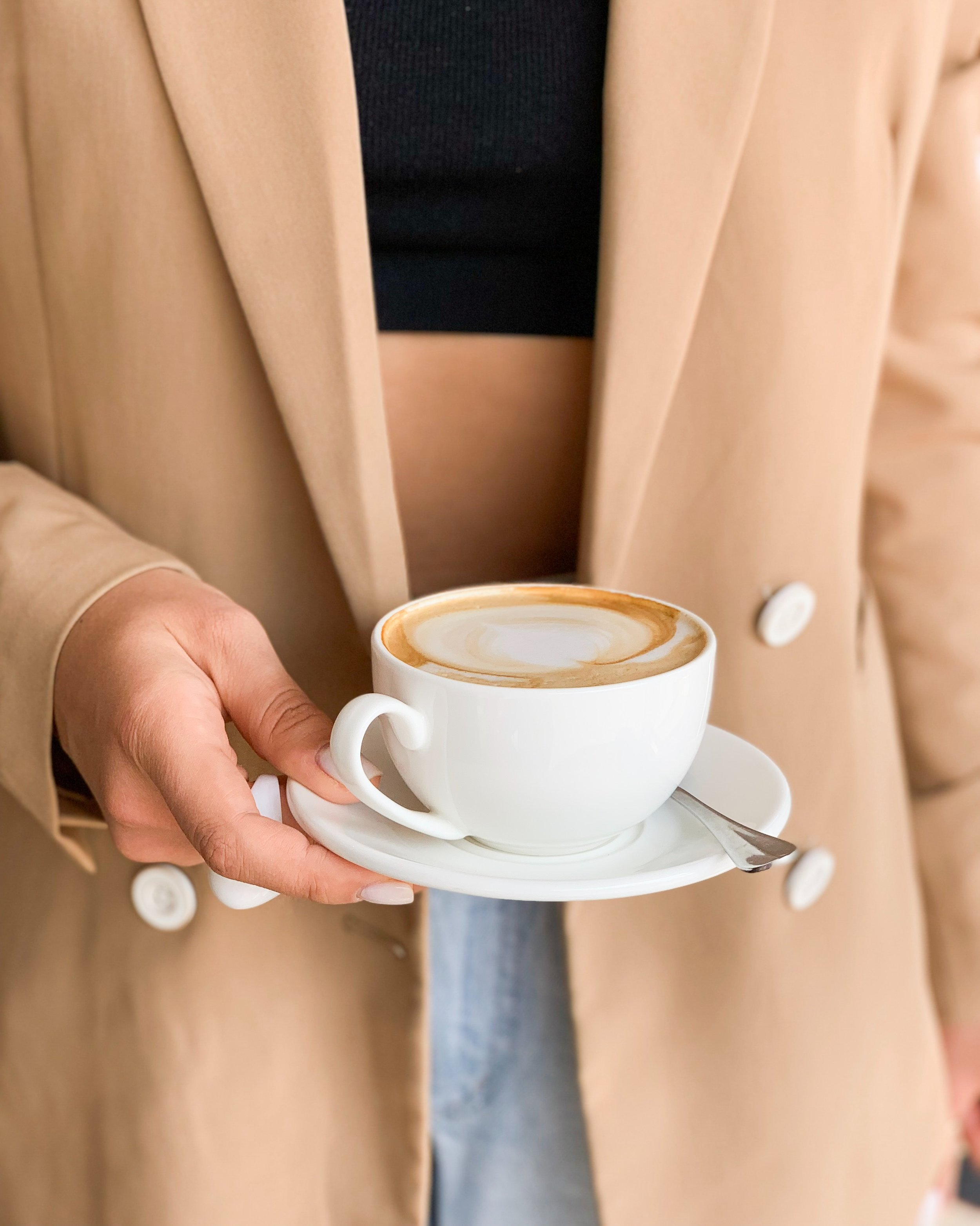 Woman holding a cappuccino