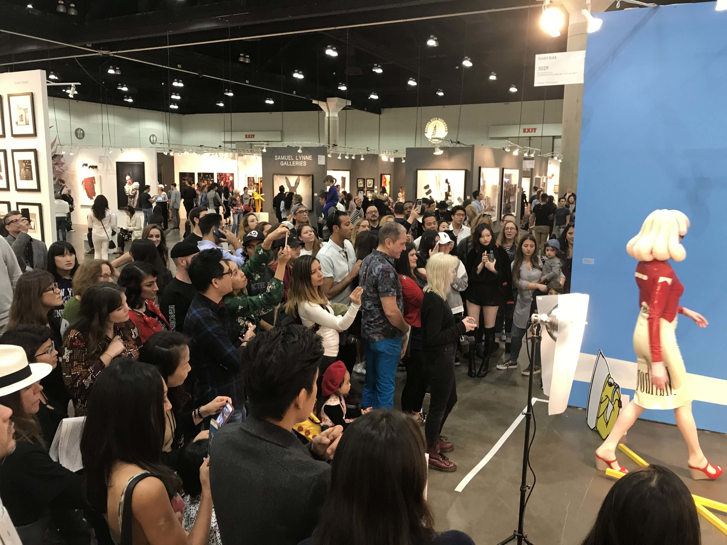 Pandemonia surrounded by the crowd and media at LA Art Show 2018