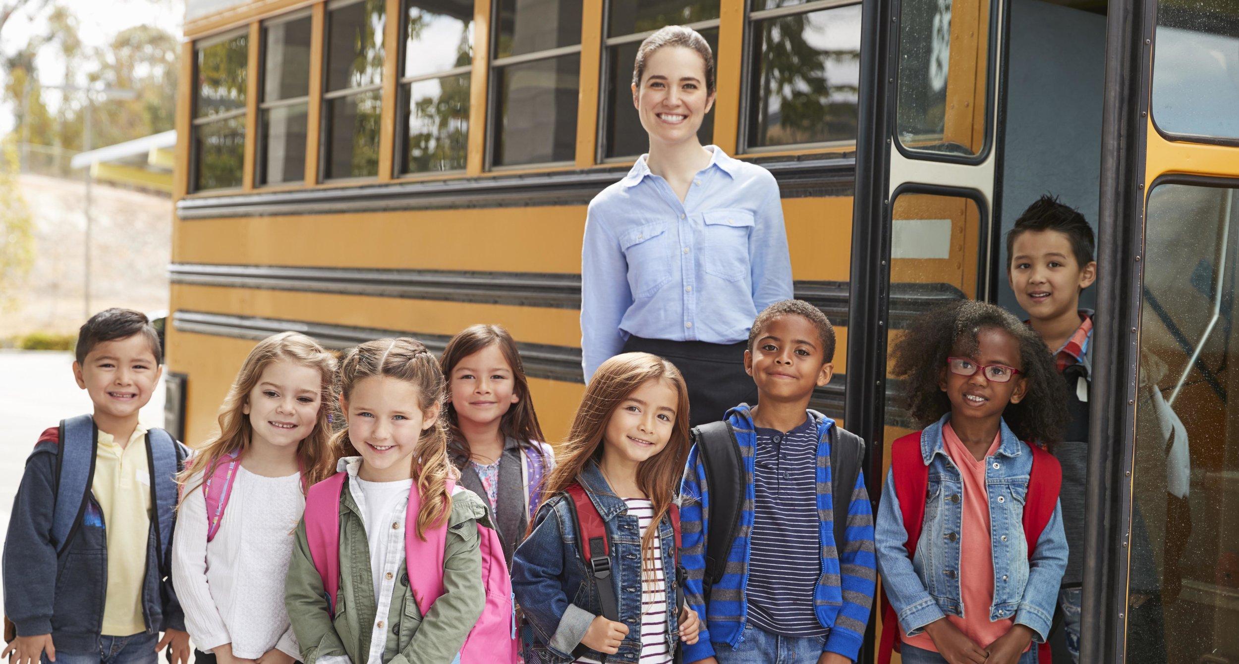 iStock-Teacher-Kids-Bus-Cropped.jpg