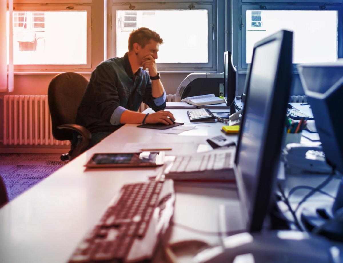 SwiftFox-Website-Man-Desk.jpg