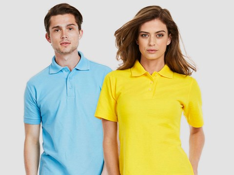 Man Wearing Light Blue Polo Shirt & Woman Wearing Yellow Polo Shirt