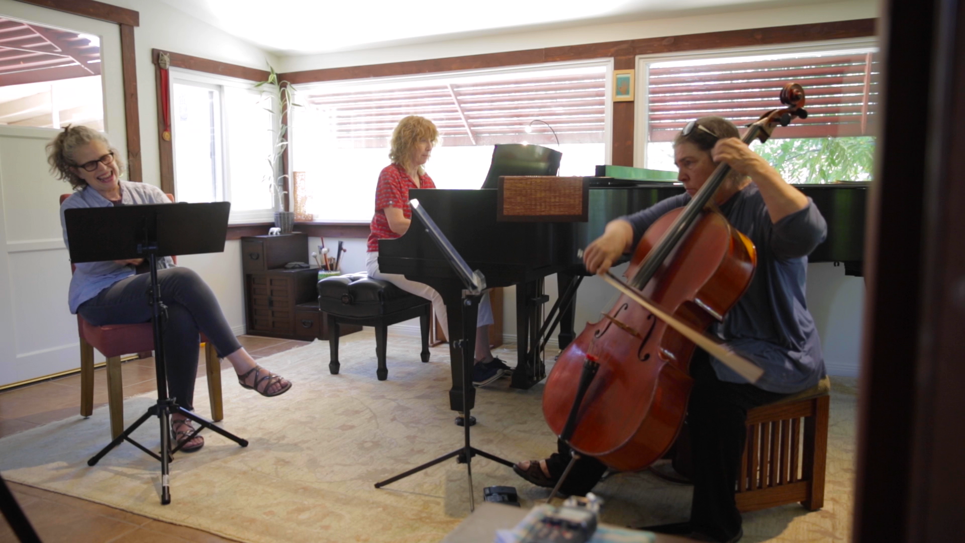 Composer Kitty Brazelton watches pianist Vicki Ray and cellist Erika Duke-Kirkpatrick play through  Down from the High Cliff  (2017) for the first time in July 2019. Brazelton composed the duo in tribute to her centenarian father's fierce battle to live.