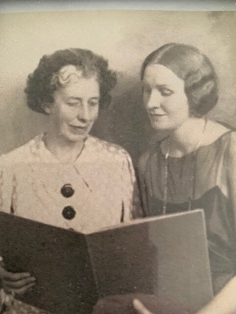 Esther McCullough and Stell Andersen read a music folio together
