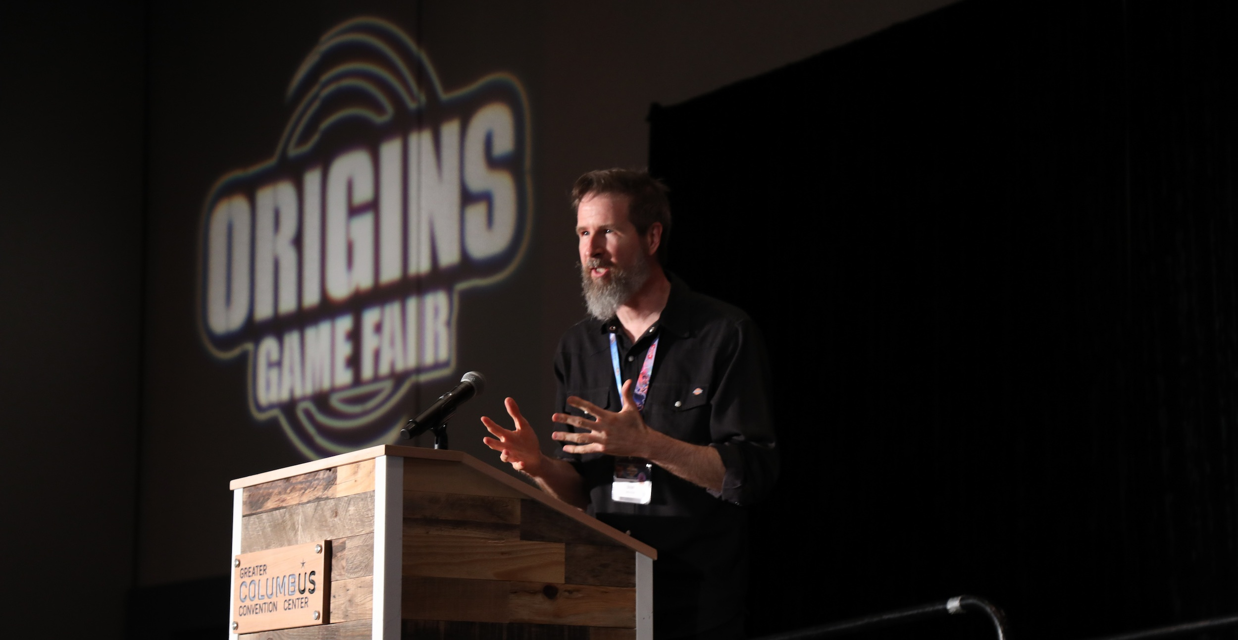 Artist BROM giving an acceptance speech during his induction into the Hall of Fame at Origins Game Fair 2019.
