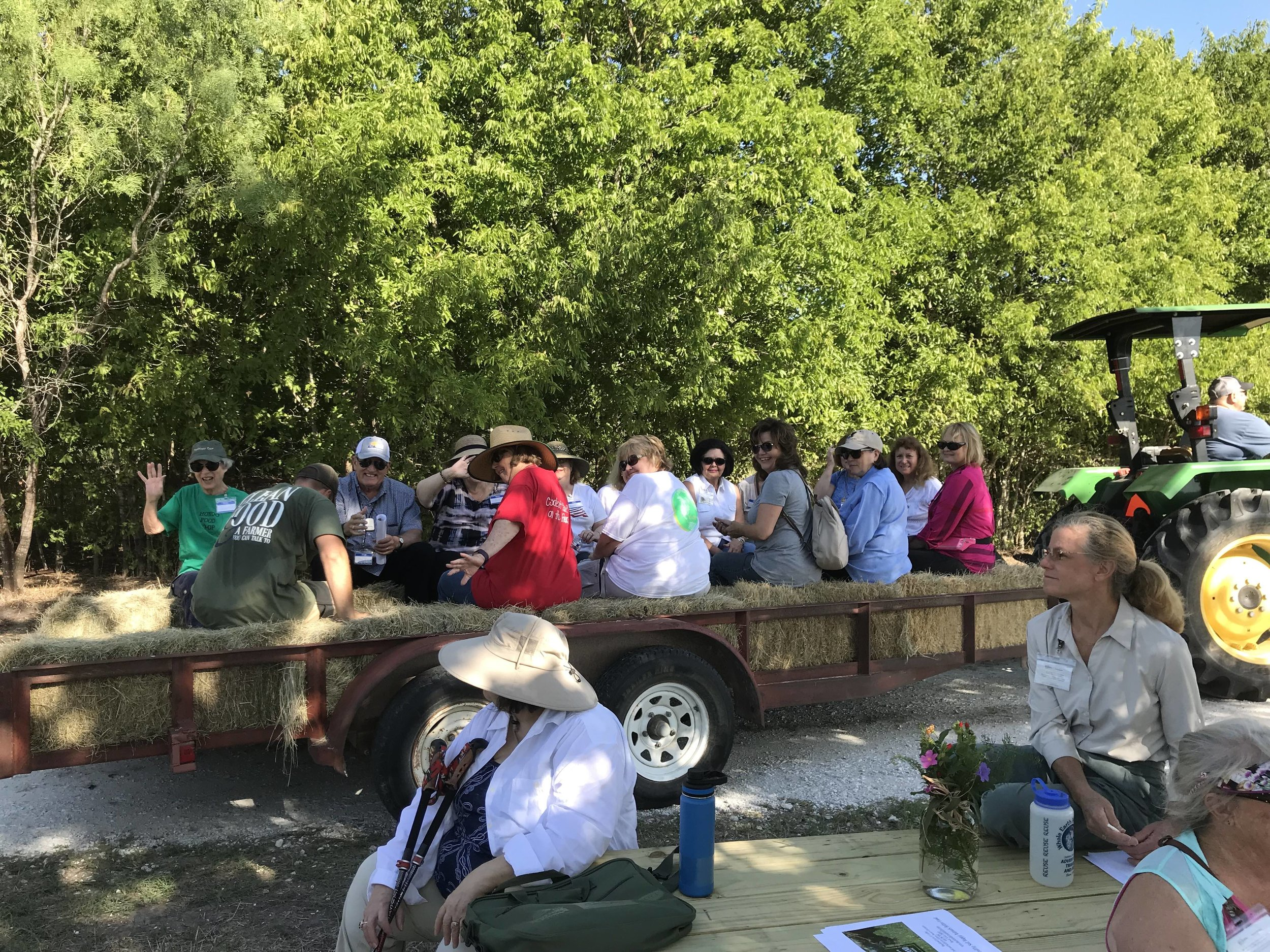 I'm glad that we could take everyone around on a trailer, because it was already hot by 10 AM! Thanks to our in-laws/parents for helping with the hayride and being an extra set of hands. (Photo by Heather White)