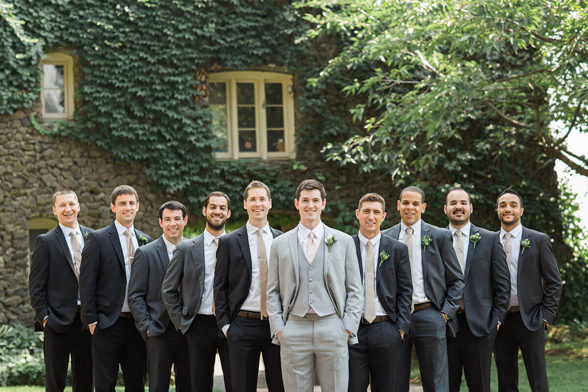 A photo of a groom and his groomsmen