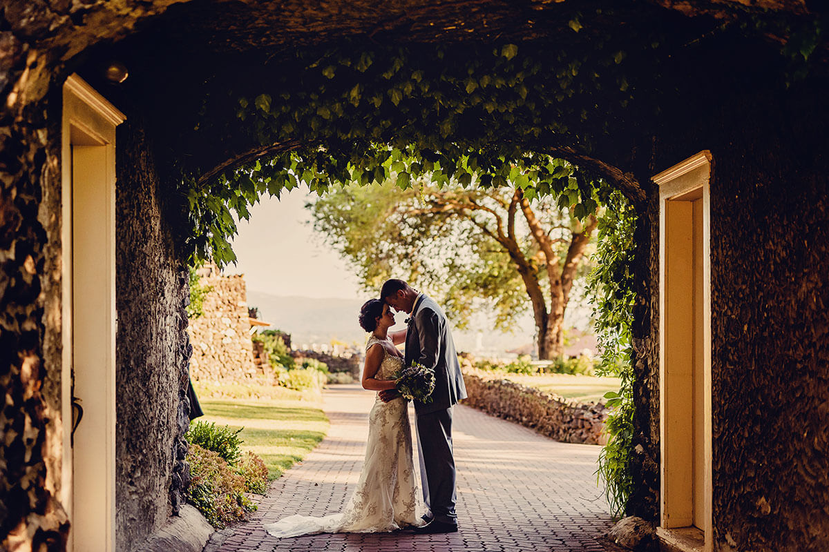 A photo of a couple kissing in the gatehouse
