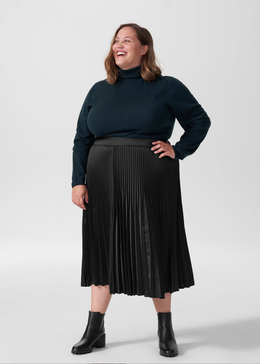 3. Robin Allen Segment- black pleated skirt- drk blue turtleneck.png