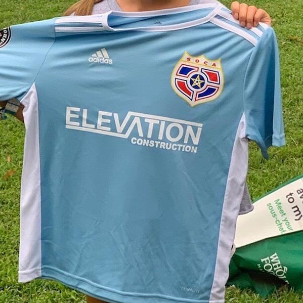 Elevation's future champion girls soccer team got their new uniforms!