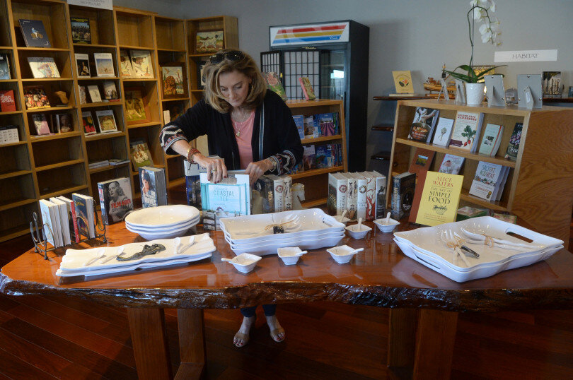 Cheryl Popp, owner of Sausalito Books by the Bay, sets out books in her shop on Monday. (Alan Dep/Marin Independent Journal)