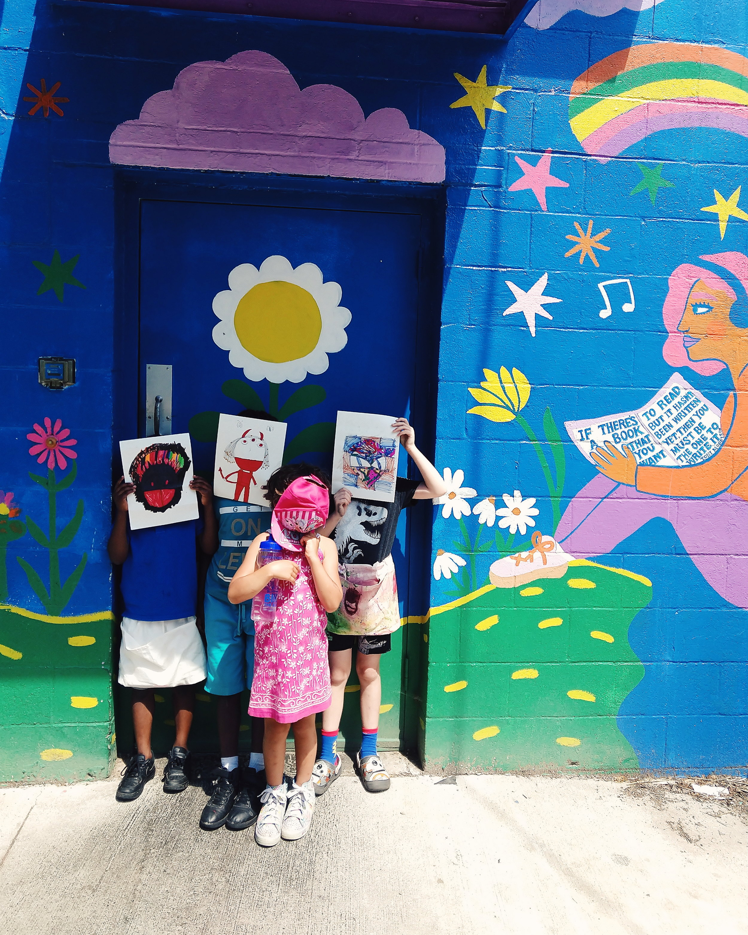 Kids from art camp in front of Lesley Numbers mural