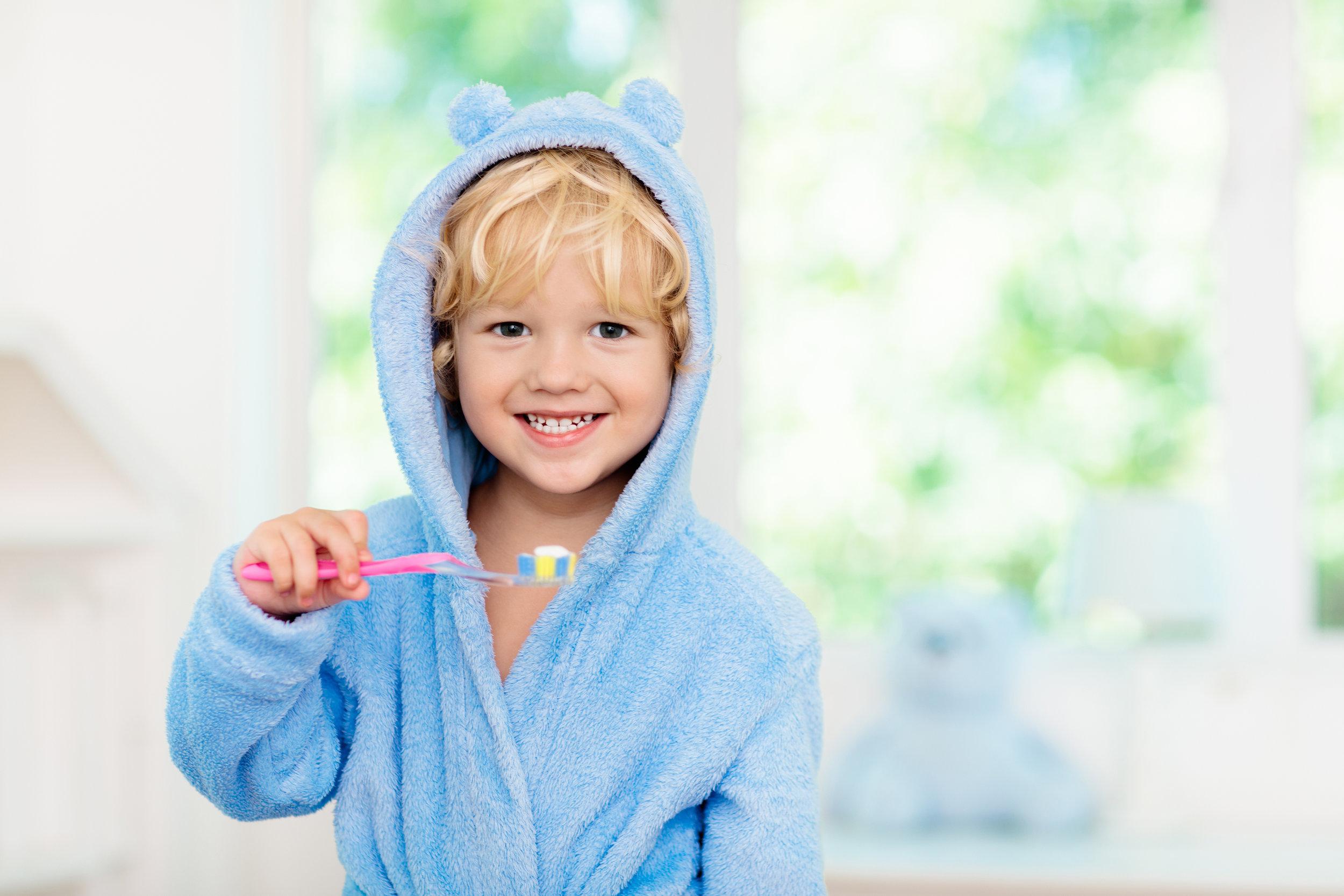 Premier Dental Care Brushing Teeth.jpg
