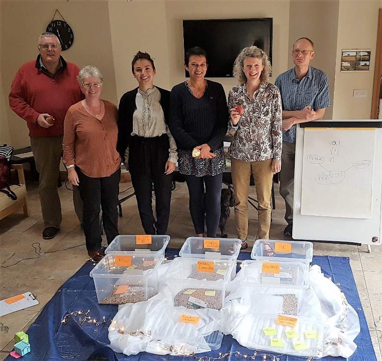 The Cart Shed team. This photo is from our session exploring concepts of cloud storage, security, access and information structure using tarpaulins, fabric, fairy lights, bird seed, string, and storage boxes. Who knew the subject could be such fun? Even the dog joined in.