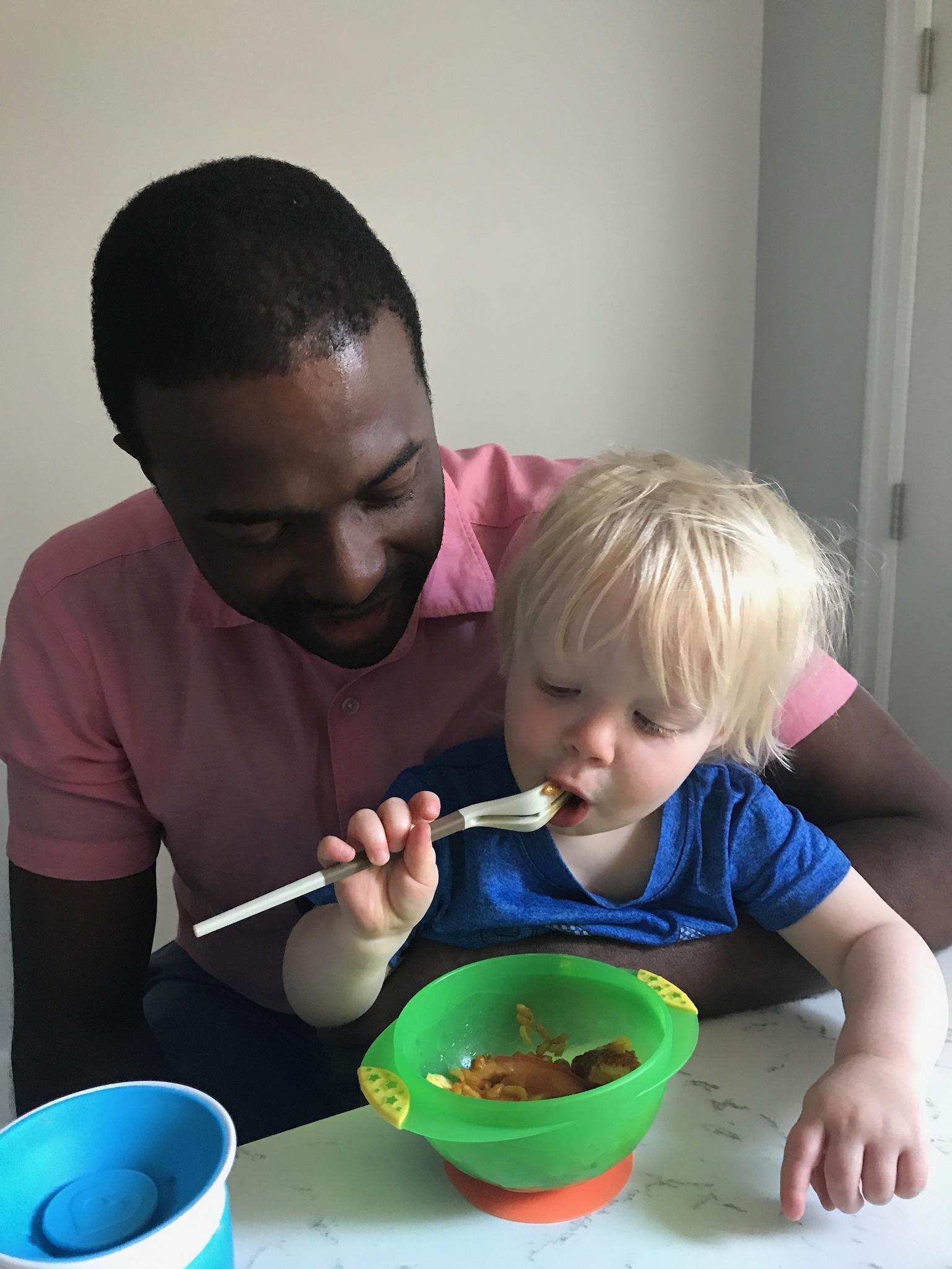 Helping Marc eat dinner