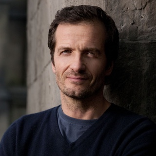 David Heyman - David began his career as a runner, locking-off sets and making copious amounts of tea on films like A Passage To India and Ragtime. He went on to work as a Creative Executive at Warner Bros. and a Vice President at United Artists, before becoming a producer in his own right.David's films have grossed over $10 billion worldwide. He is perhaps best-known for producing all eight Harry Potter films, the Academy Award® winning Gravity, and both adaptations of Michael Bond's Paddington books. Other films he has been involved with include Juice, I Am Legend, We're The Millers, The Fault in Our Stars, Maze Runner and Fantastic Beasts. Upcoming projects include new films from Quentin Tarantino and Noah Baumbach.