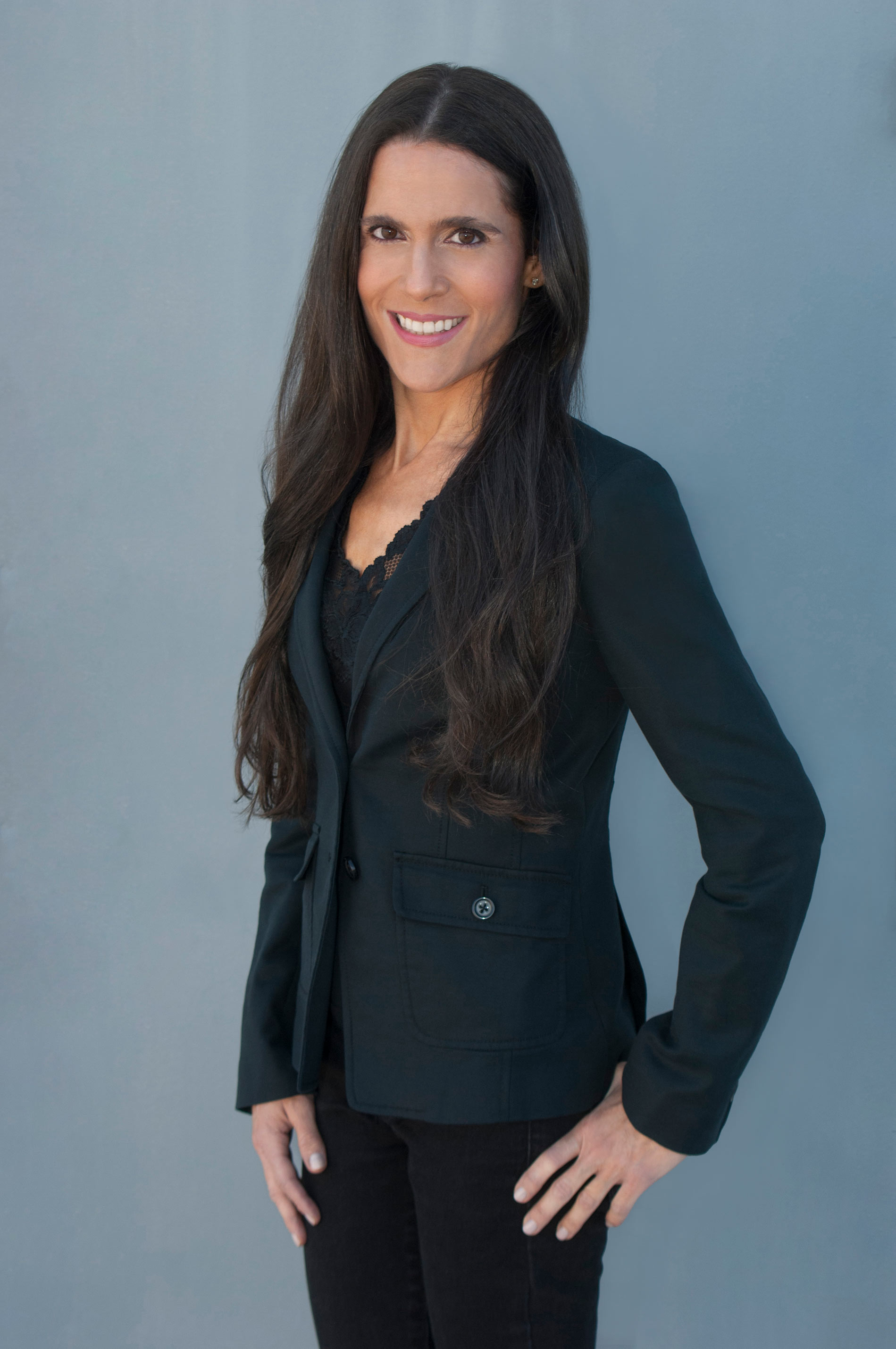 Dr. Alison Mitzner in black suit, pediatrician, mom expert, fit doc
