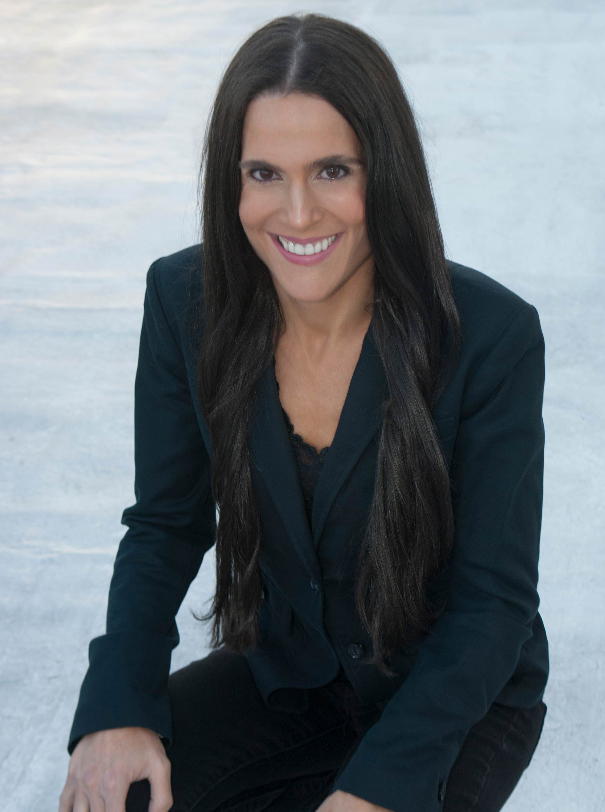Headshot of Dr. Alison Mitzner in black suit, a New York City-based board certified pediatrician, mom, fitness expert, and media contributor